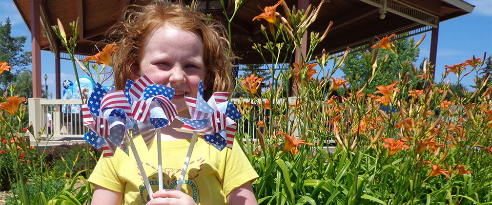 Girl with pinwheels on 4th of July event