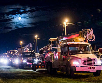 FPL trucks at night